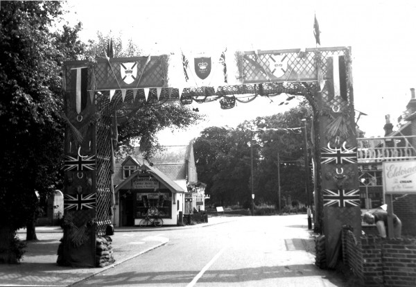 1953 Coronation Arch over High Street by Post Office Corner.