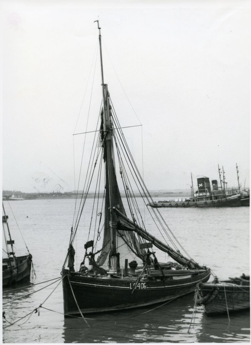 LO406 ( THISTLE ?) moored off Gravesend in the 1930s. A gaggle of ship tugs lie in the background, with CHALLENGE nearest to the camera.