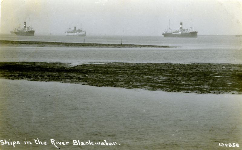 Ships in the River Blackwater post card no. 122858. Postally used 1932. The prominent ships on the left and right are Nelson Line M class. The vessel in the centre is HIGHLAND WARRIOR. Date: Before 7 December 1932.