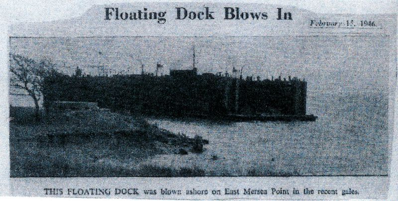 This Floating Dock was blown ashore on Decoy Point in the recent gales. Newspaper cutting dated Feb 15, 1946. Date: 15 February 1946.