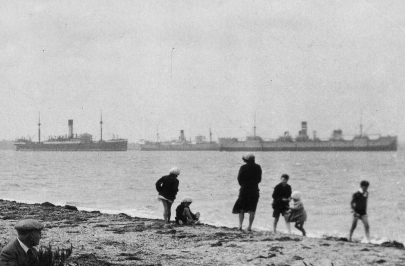 Part of a postcard of The Shore, Bradwell on Sea, taken 1931-32. The ships are believed to be a Blue Funnel liner, PORT CURTIS and HIGHLAND WARRIOR. Date: Before 7 December 1932.