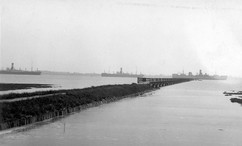 Laid up ships off Tollesbury Pier, c1932. HIGHLAND WARRIOR is at the end of the pier. Part of a postcard, 126359. Date: c1932.