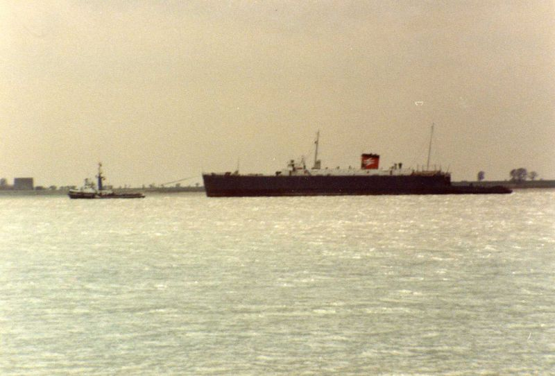NORFOLK FERRY leaving for the breakers under tow Date: 15 April 1983.