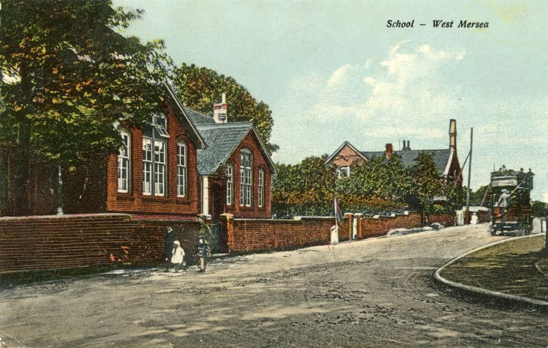 School - West Mersea. Looking up Barfied Road with a Berry's bus in the distance. The 1899 school building is on the left. 