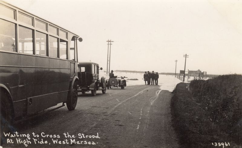 Waiting to cross the Strood at high tide. At the front of the queue is an RAC motor cycle, perhaps expecting some work. 