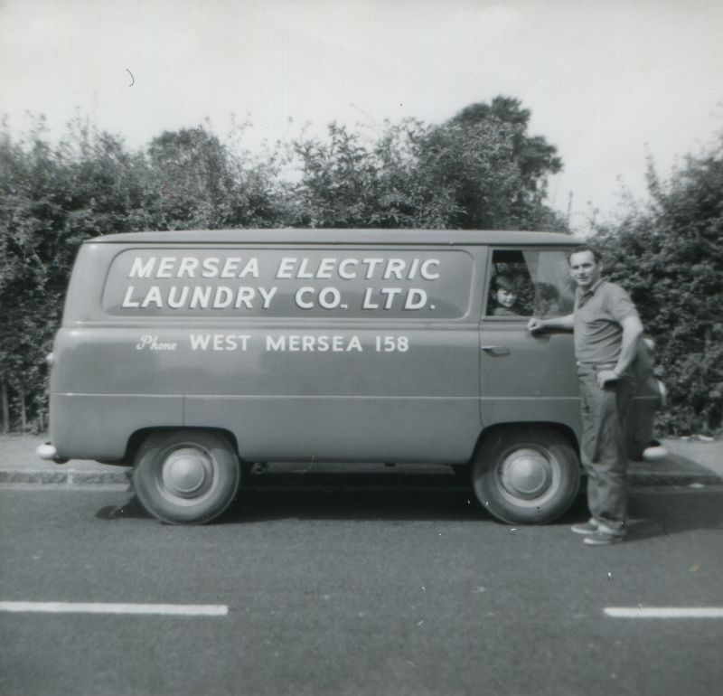 Mersea Electric Laundry Company van. It used to be driven by Ivan King. The man in the picture is a visitor from London. 