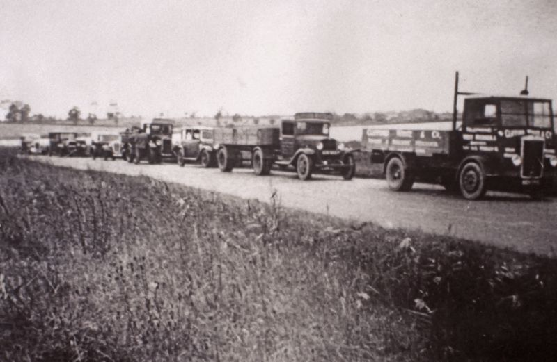 Waiting for the tide at the Strood. Clifford White's lorries on the right.
