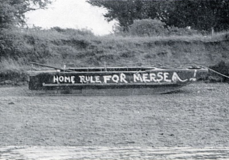 Home Rule for Mersea. Slogan on an old wartime pontoon at the back of Ray Island. During the war, several of these were kept at the Strood in case of emergency. After the war, Ernie Richardson was living in a shed built on top of one at the time of the 1953 flood. He was rescued, well on his way to Brightlingsea.