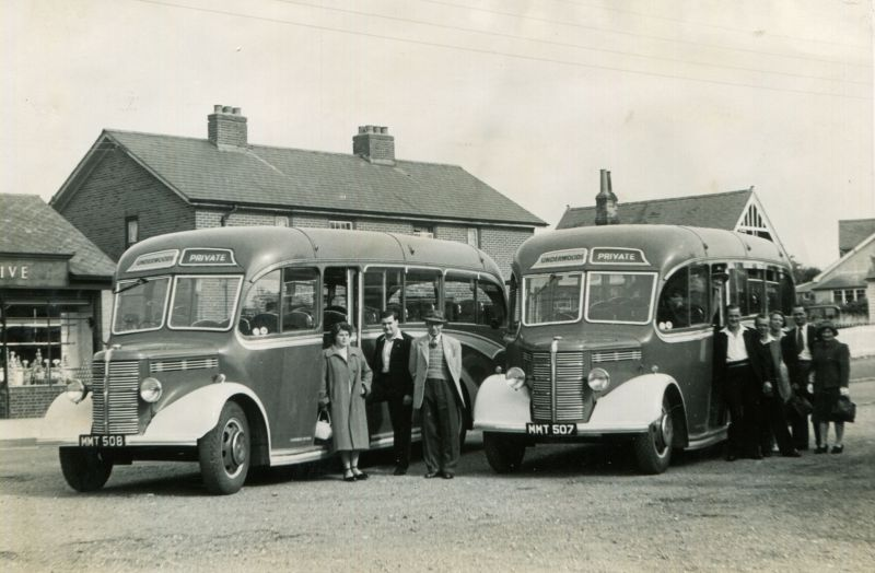 Underwoods Coaches. In front of the left coach are Mrs Dick Greenleaf, Eric Stacey (driver), Cooty Hoy. In front of the right is Percy Green.