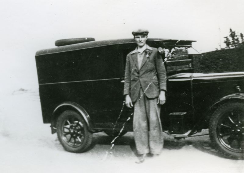 Mr Reg Sales in the employ of Mr Angus at Howards Store. The van was a Jowett.