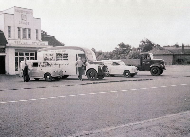 The fleet of vehicles at one time owned by the Whiting family pictured outside Underwoods Garage. Oscar Whiting on the left. Richard Whiting and the mobile shop in the centre.