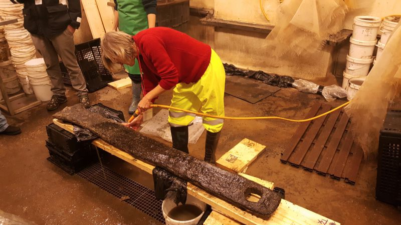 Board walk timbers found off Coopers Beach. Jane cleaning timber 4 at Museum of London Archaeology. 