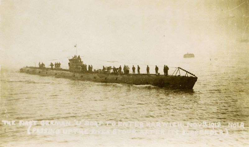 The first German U Boat to enter Harwich November 1918, passing up the River Stour after its surrender.