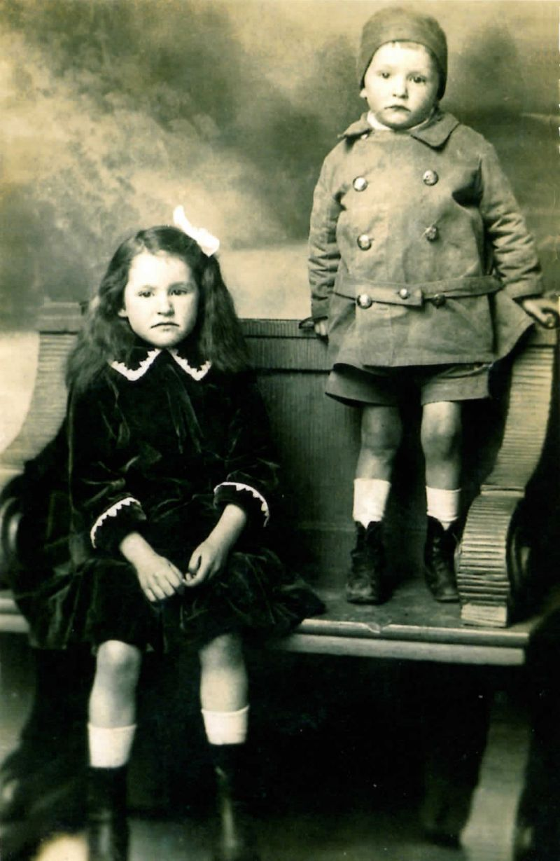 Kathleen and Jack Powell, children of Thomas Powell who was Professional at Mersea Island Golf Club. Jack was born 1913 at the Golf House, East Mersea - he is wearing the leather hat that his father Thomas had made from the bottom of a golf bag. 