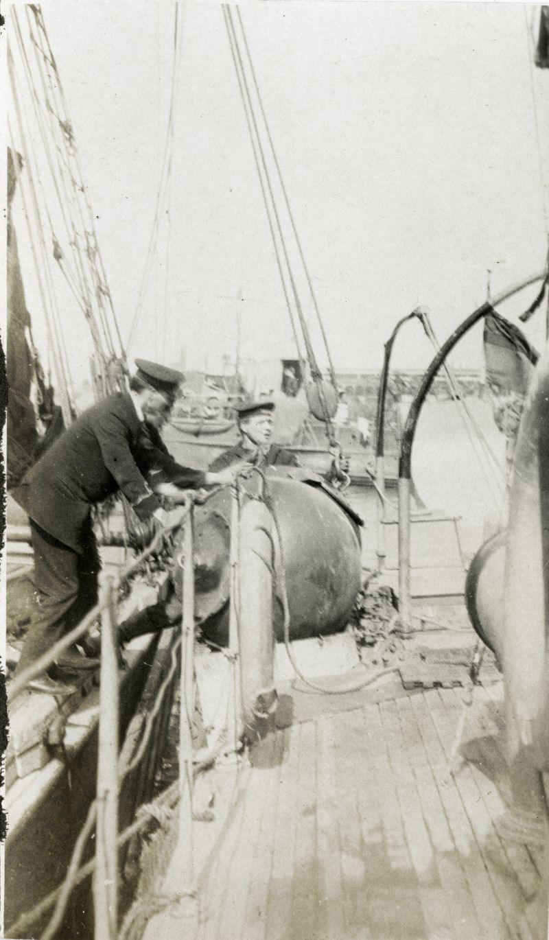 Loading up mines - onto a Naval vessel from a sailing barge. Photo from G.R. 'Ronnie' Hone ?