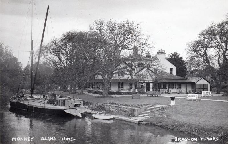 Monkey Island Hotel, Bray on Thames. The barge is the former Eastwood's brick barge IOTA after conversion to a yacht. Built 1898, Official No. 108327.