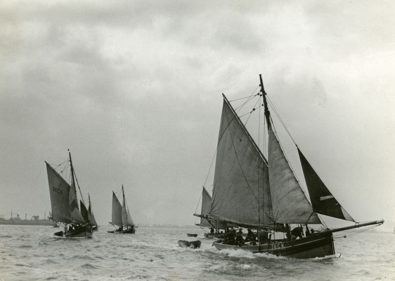 Smacks beating over the tide in the River Blackwater. Date: 1930s.