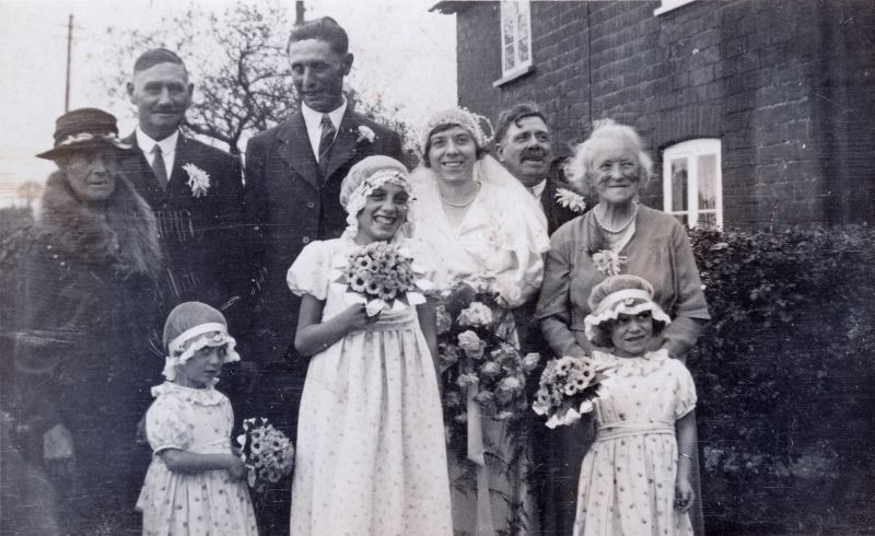 27. ID GWC_009 Wedding of Kate Goody and Ernest Wyncoll. Photograph taken outside Barnards Cottage, Peldon - home of the bride's parents.