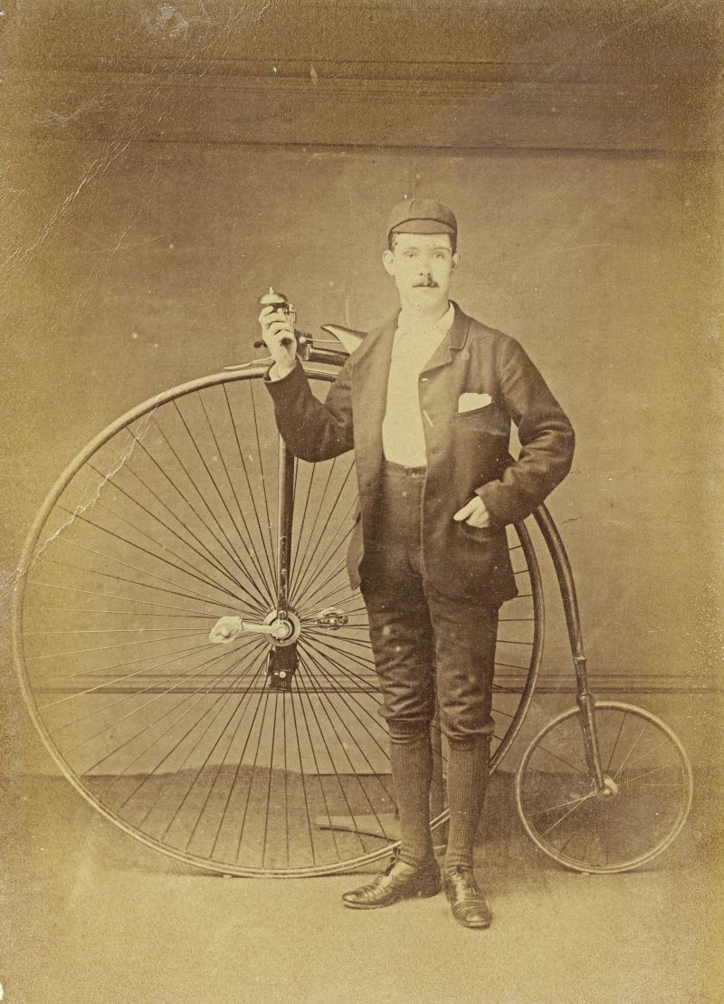 Spring Robert Wyncoll and his Penny Farthing. Writing on the back of the photograph dates it as 1888. Photograph by P. Damant, Mersea Rd., Colchester.
