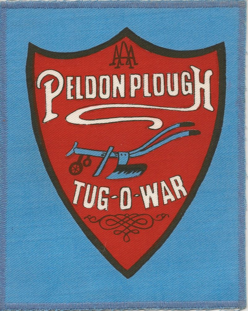 Peldon Plough Tug of War Team Badge designed by John Fell during 1981. 