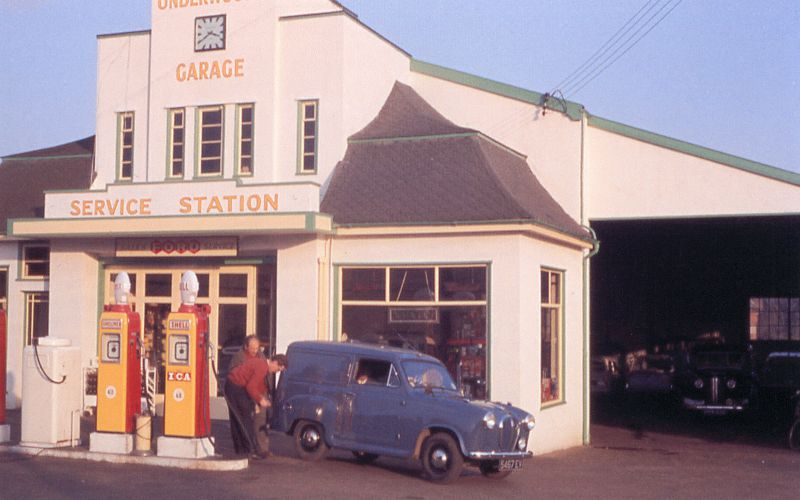 Underwood's Garage. In the picture are Fred Oppezzo and Jacky Wenlock. Austin Van 5467EV. Shell Mex petrol is 4/2 a gallon (4 shillings and 2 pence) and with ICA (Ignition Control Additive) is 4/8 a gallon.