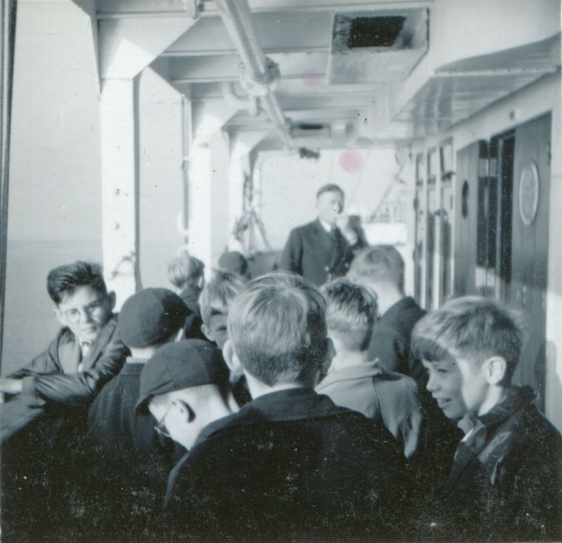 School trip from Heybridge to the liner GOTHIC while she was laid up in the River Blackwater. Walter Bibby, the donor's father, was a master at the school. Date: cJuly 1957.