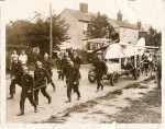 8. ID BS01_034 Mr Charles Scott's journey through the village, towed by firemen. C.W.A. Scott was an aviator who had flown to Australia. He was a Mersea resident. Picture was...