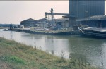 27. ID SHP_STC_608 BANDICK loading grain at Colchester Hythe in the 1970s. Beyond her, extreme left, is the COLNE DREDGER.